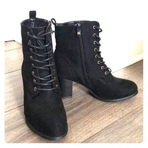 High heeled black boots